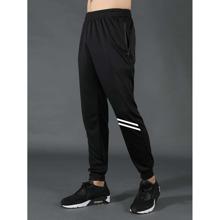 Pantalones deportivos con estampado de rayas