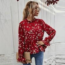 Bluse mit Blumen Muster, abfallendem Saum und Schosschen