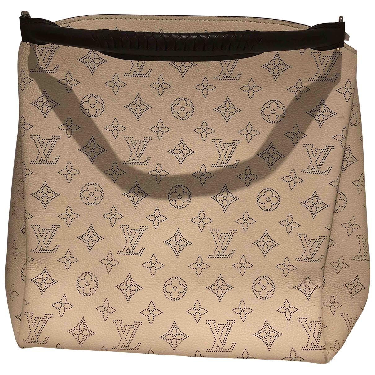 Louis Vuitton - Sac a main Babylone pour femme en cuir - ecru
