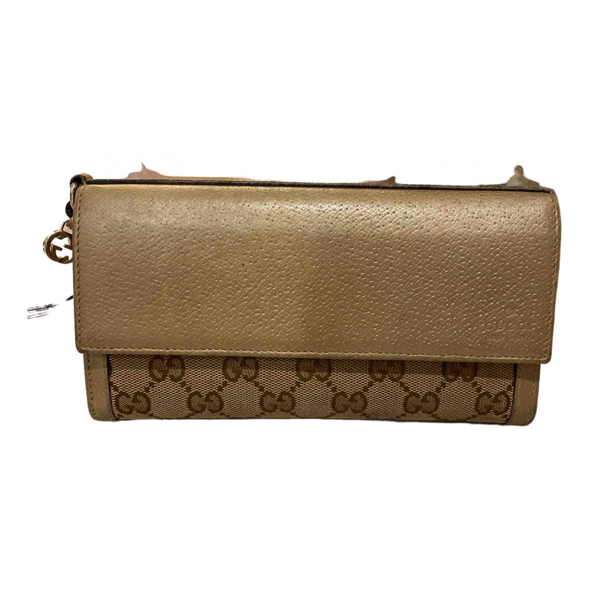 Gucci \N Portemonnaie in  Gold Leinen