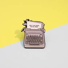 Broche de maquina de escribir para niños