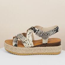 Sandalias con plataforma con tiras con hebilla con estampado de piel de serpiente