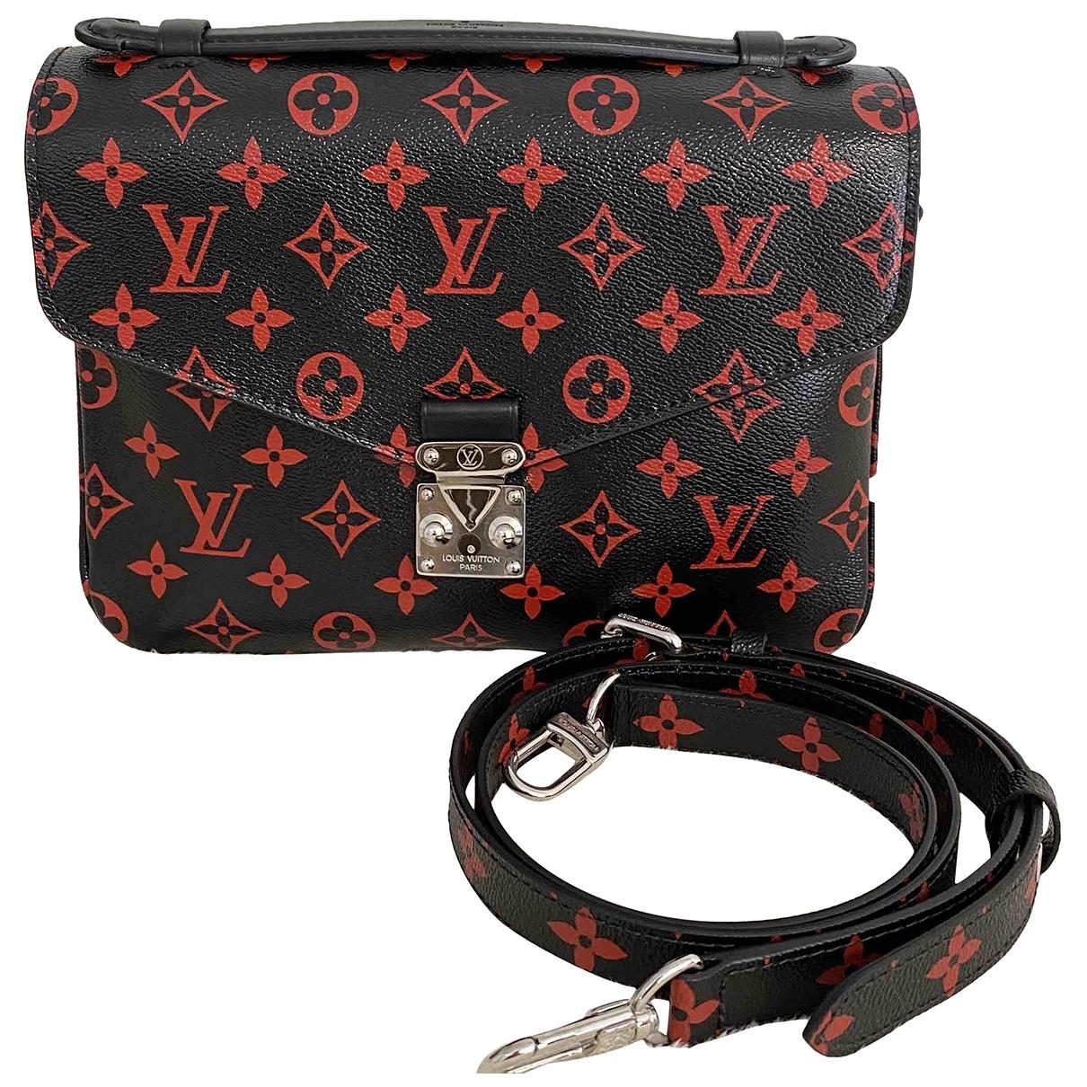 Louis Vuitton Metis Handtasche in  Schwarz Leinen