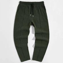 Pantalones con costura delantera de cintura con cordon
