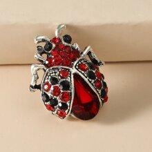 Broche con diseño de animal con piedra preciosa