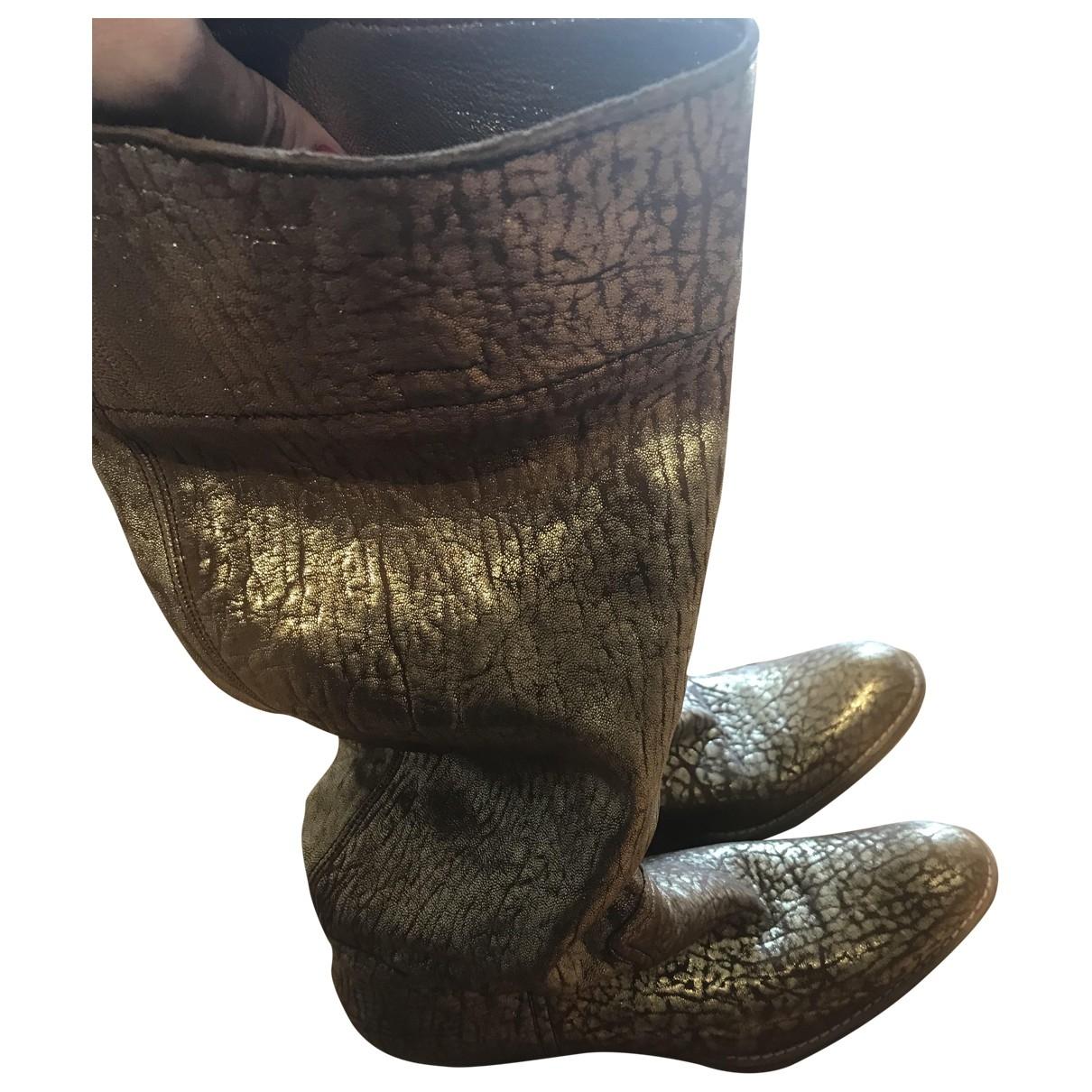 Miu Miu \N Gold Leather Boots for Women 38.5 EU