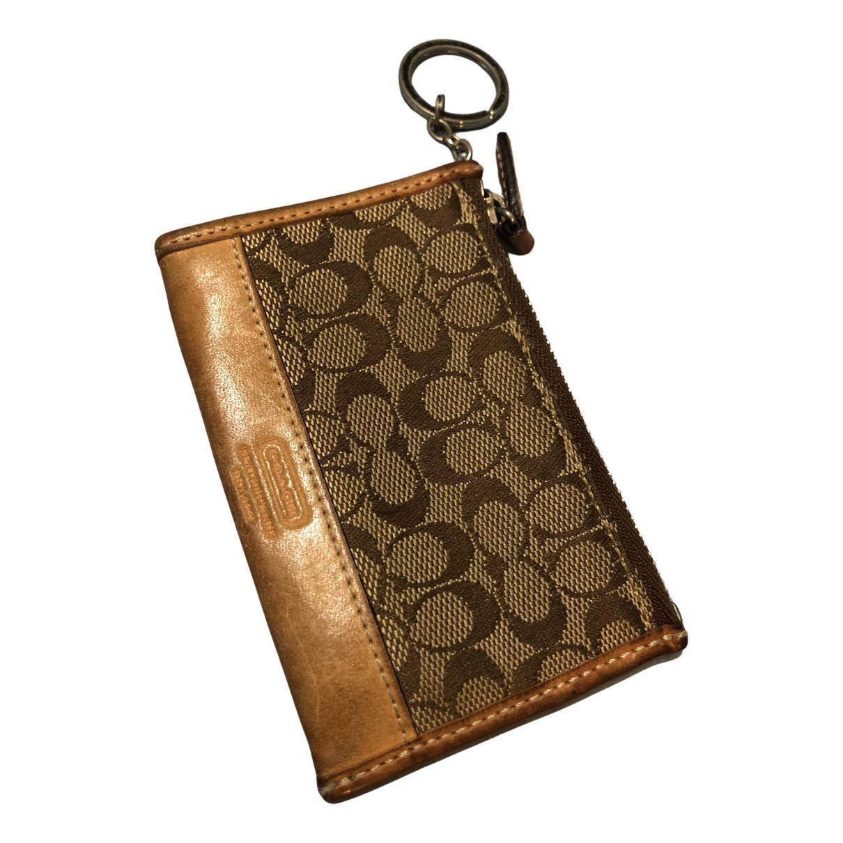 Coach - Portefeuille Cartable mini sierra pour femme en cuir - beige