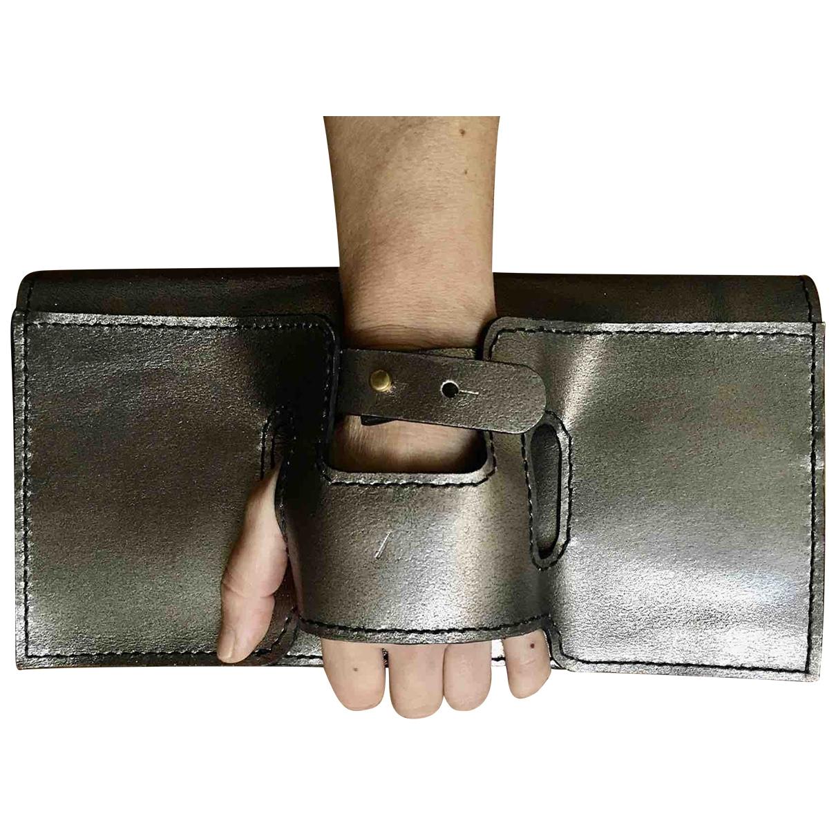 - Pochette   pour femme en cuir - metallise