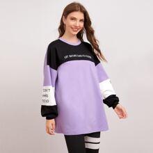 Pullover de color combinado con estampado de slogan