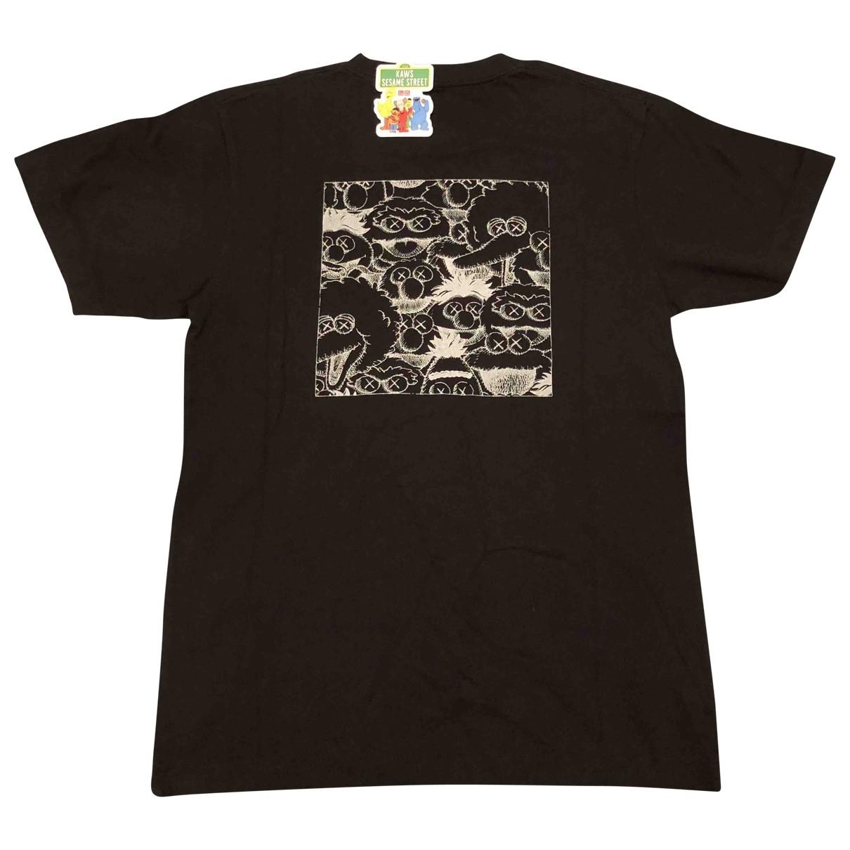 Kaws X Uniqlo - Tee shirts   pour homme en coton - noir