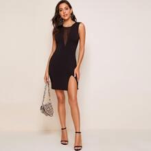 Kleid mit Netzeinsatz und Schlitz am Saum