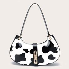 Bolso baguette con cerradura girante con estampado de vaca