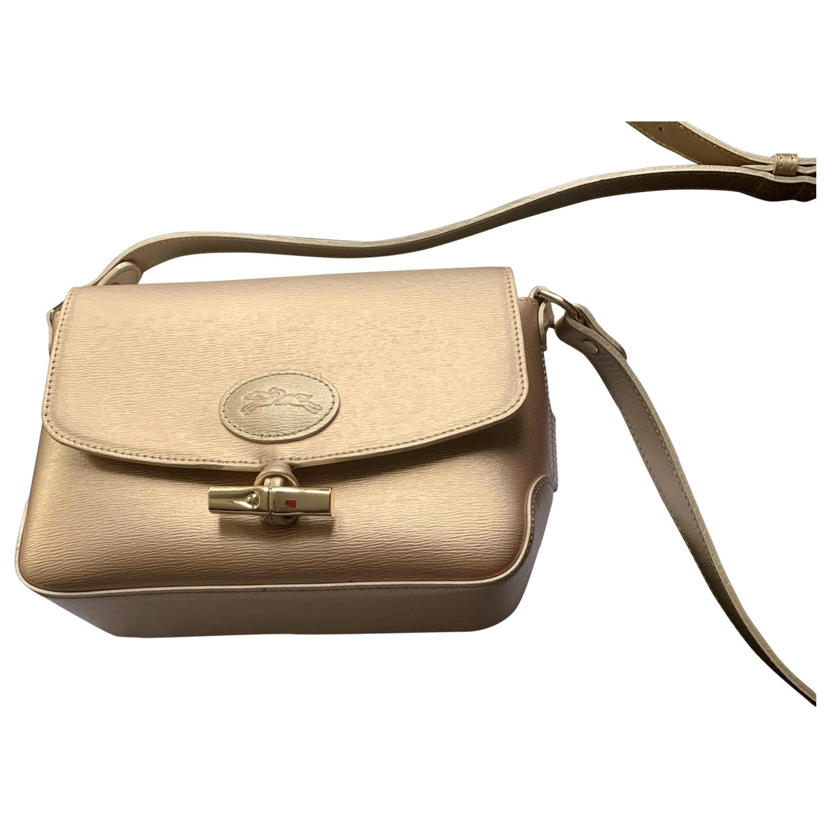 Longchamp \N Gold Leather handbag for Women \N