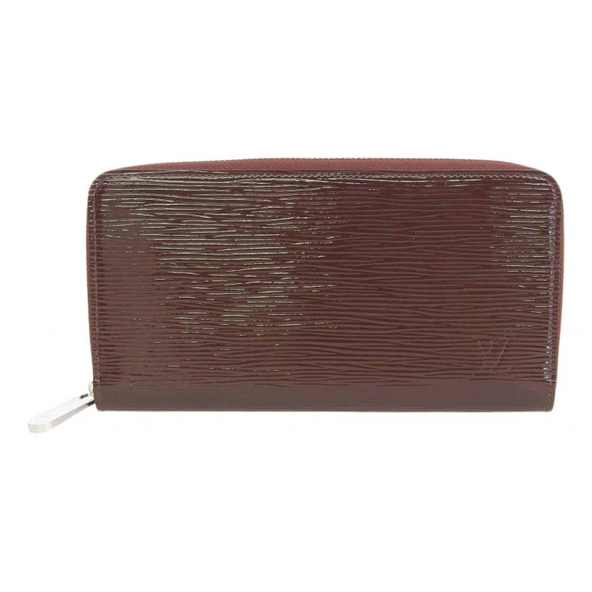 Louis Vuitton - Portefeuille Zippy pour femme en cuir verni - marron