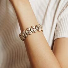 Pulsera con diseño de flor con diamante de imitacion