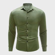 Camisa unicolor con boton