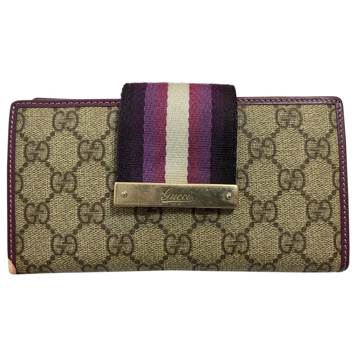 Gucci - Portefeuille   pour femme en toile - violet