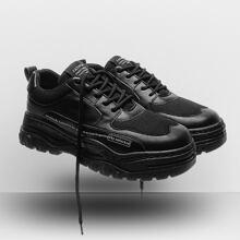 Zapatillas deportivas de hombres con slogan