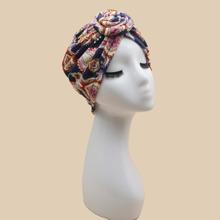 Sombrero turbante con diseño de nudo