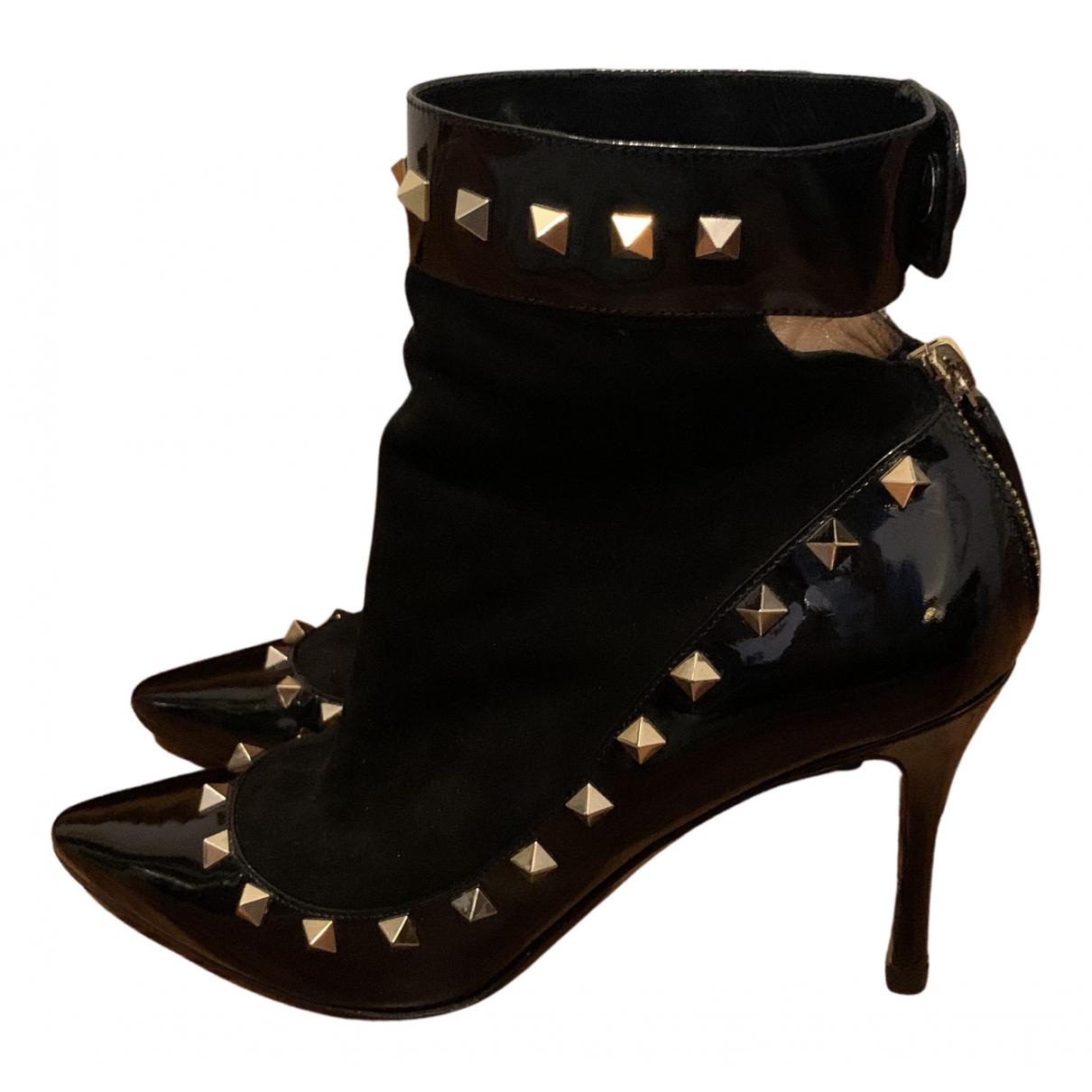 Valentino Garavani - Boots Rockstud pour femme en cuir verni - noir