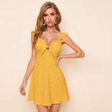 Kleid mit Knoten vorn, Raffungsaum und ueberallen Muster