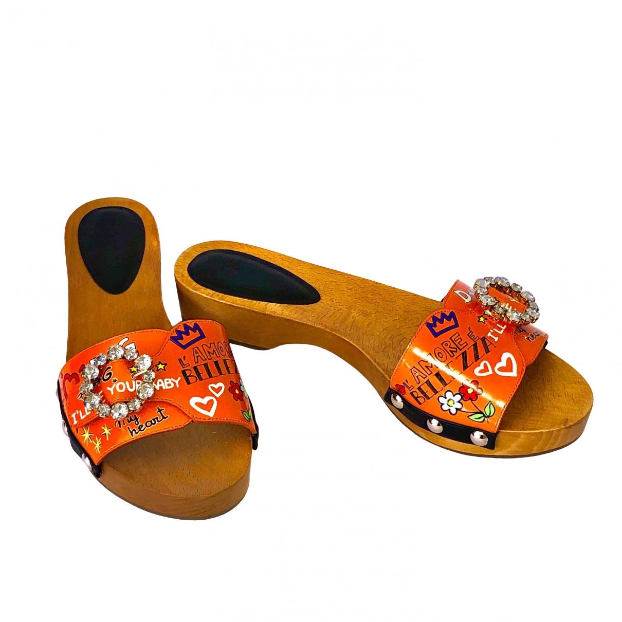 Dolce & Gabbana - Sabots   pour femme en cuir - orange