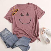 Camiseta con estampado de hoja y expresion - grande