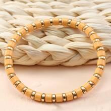 Armband mit zweifarbigen Perlen
