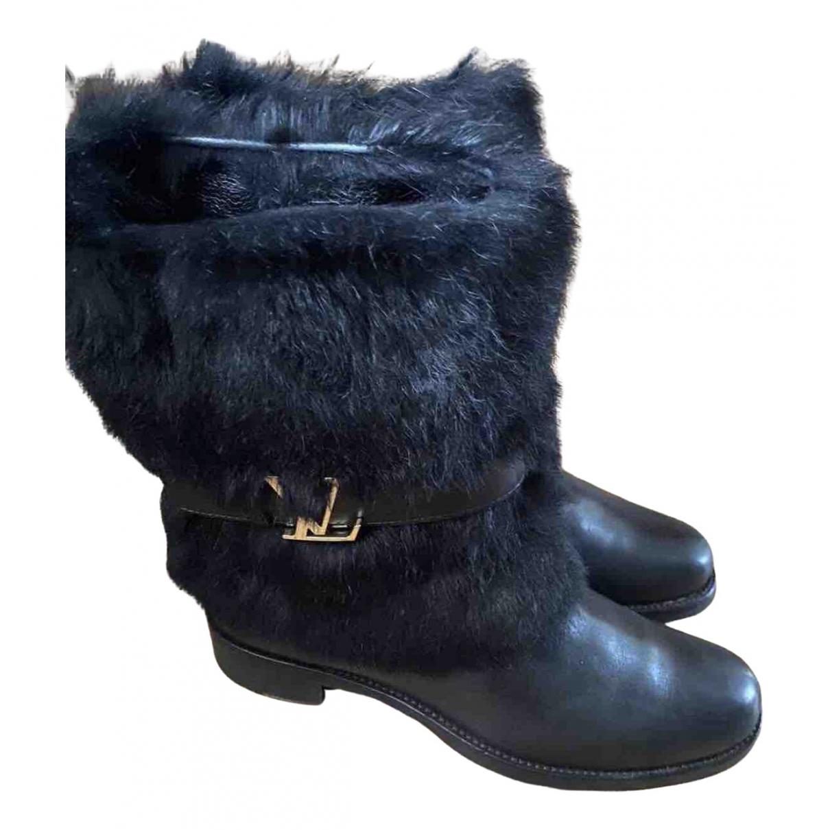 Louis Vuitton - Boots   pour femme en fourrure - noir