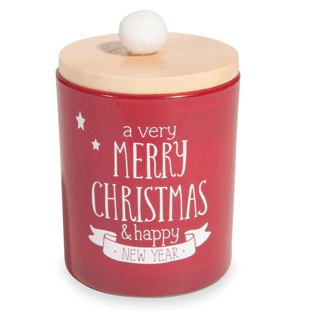 Weihnachtskerze im roten Glasgefaess mit Deckel