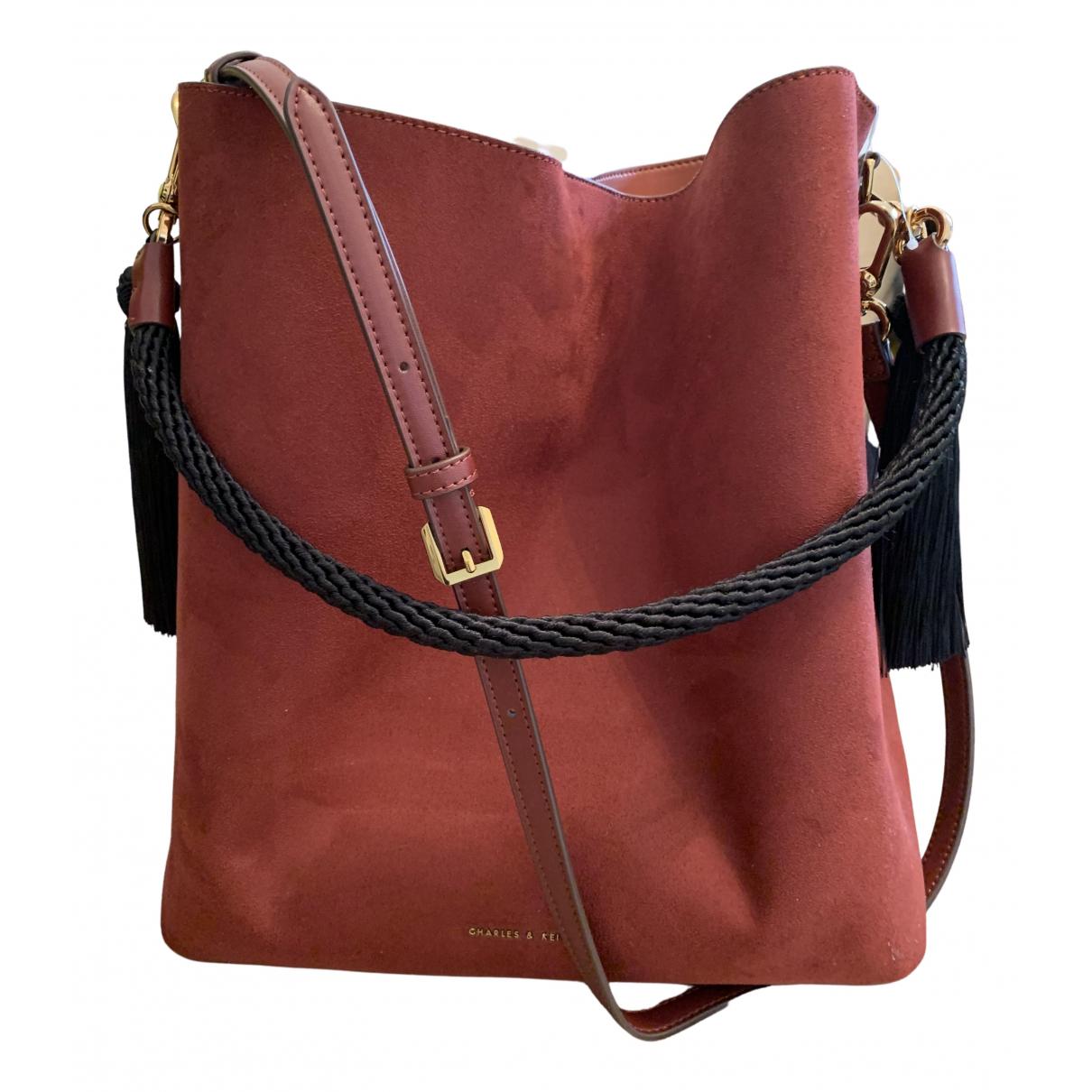 Charles & Keith N Burgundy handbag for Women N