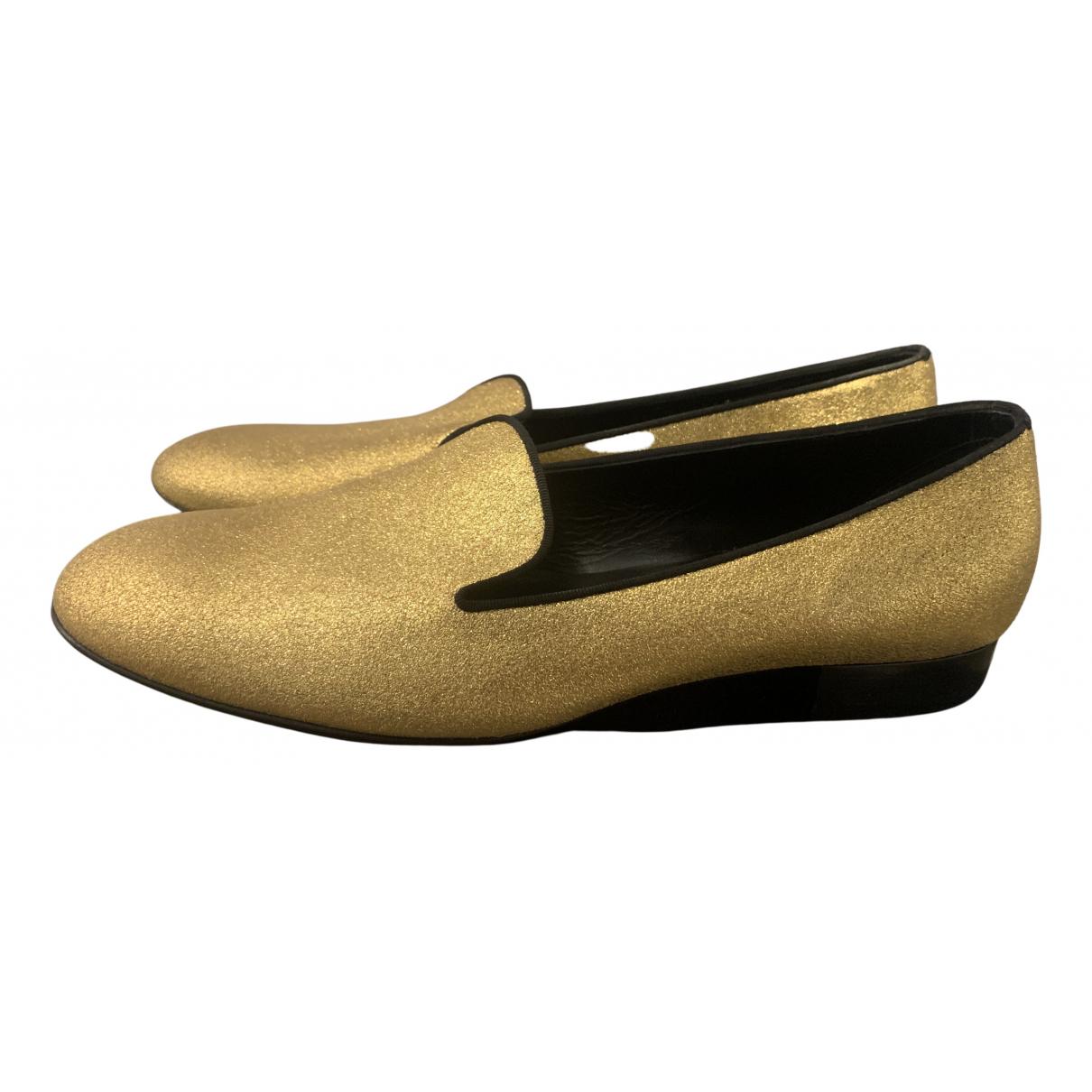 Saint Laurent \N Mokassins in  Gold Leder