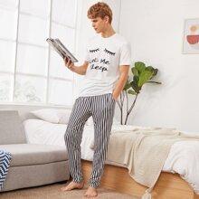 Conjunto de pijama camiseta con estampado de slogan y ojo con pantalones de rayas