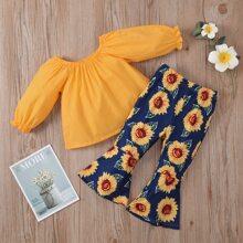 Einfarbige Bluse mit Schosschenaermeln & Hose mit Sonnenblumen Muster und ausgestelltem Beinschnitt