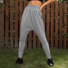 Pantalones deportivos unicolor de cintura elastica