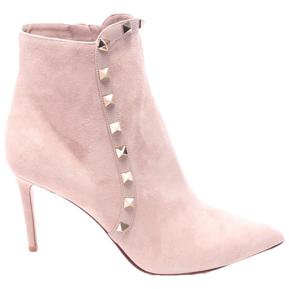 Valentino Garavani - Boots Rockstud pour femme en cuir - beige