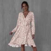Kleid mit V Kragen, Guertel und Muster