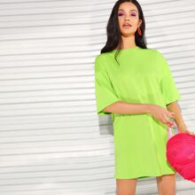 Neon Lime Kleid mit sehr tief angesetzter Schulterpartie
