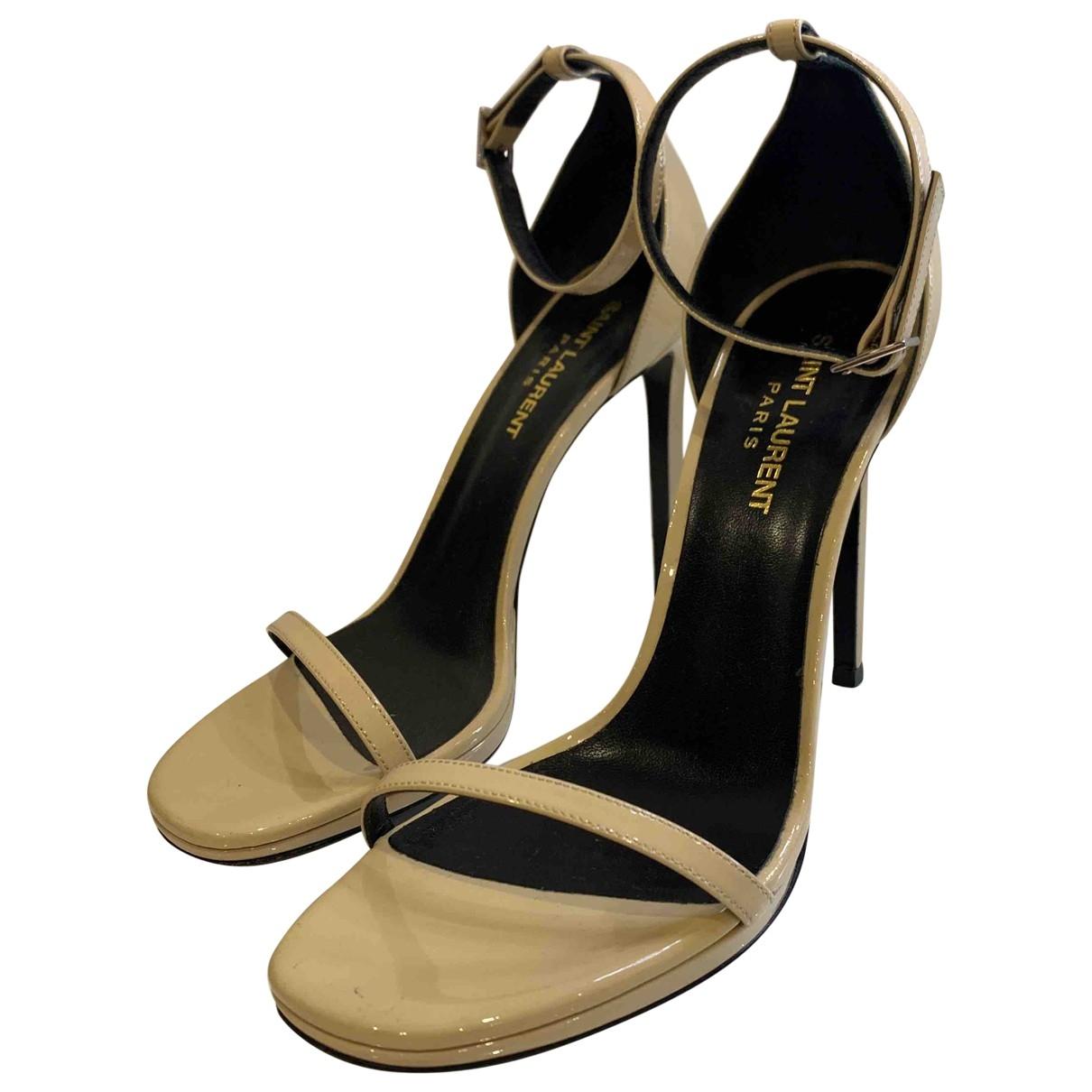 Saint Laurent - Sandales Amber pour femme en cuir verni - beige