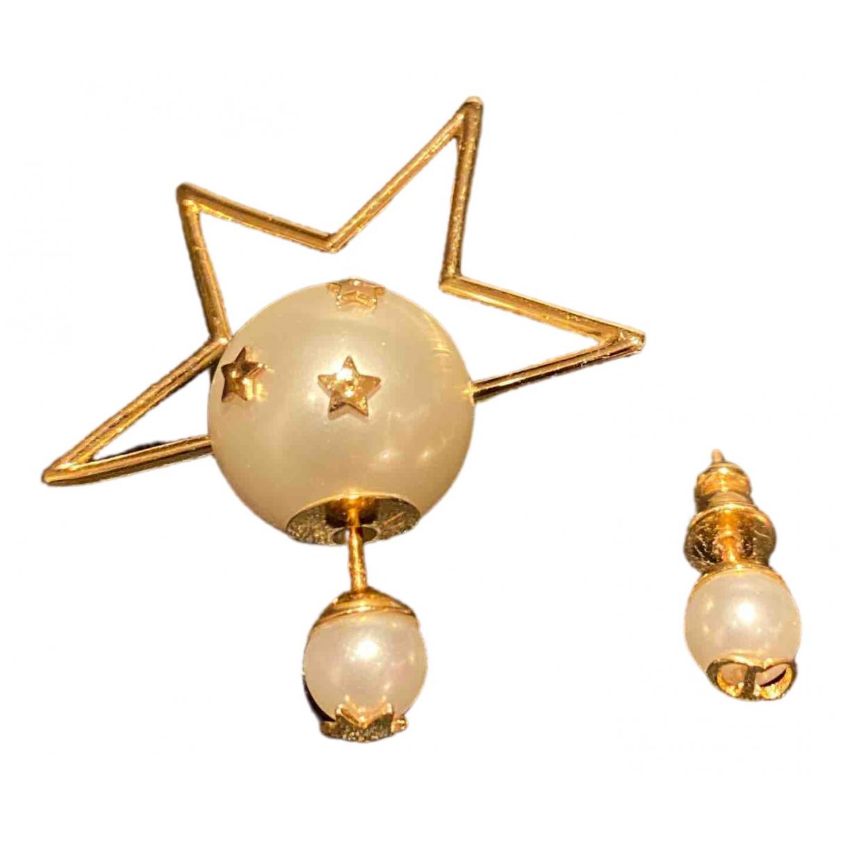 Christian Dior - Boucles doreilles   pour femme en metal - dore
