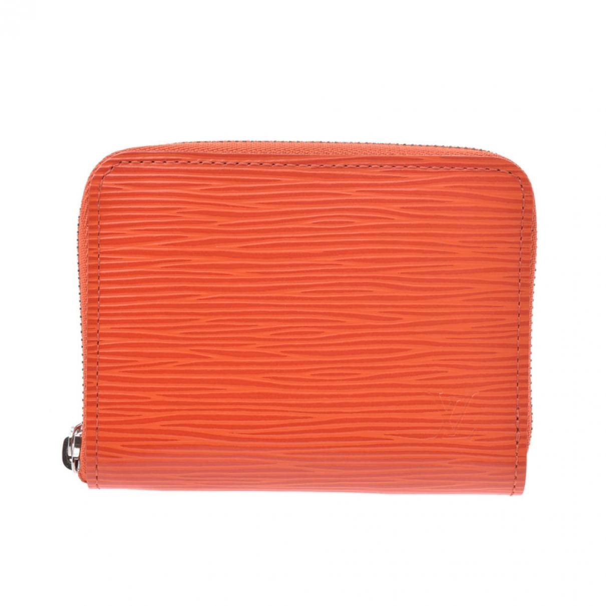 Louis Vuitton Zippy Kleinlederwaren in  Orange Leder