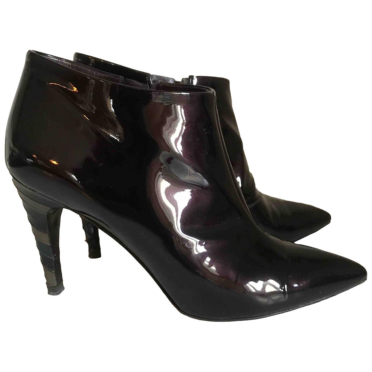 Louis Vuitton - Boots   pour femme en cuir verni - bordeaux