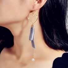 Ohrringe mit Hohle und Herzen Design