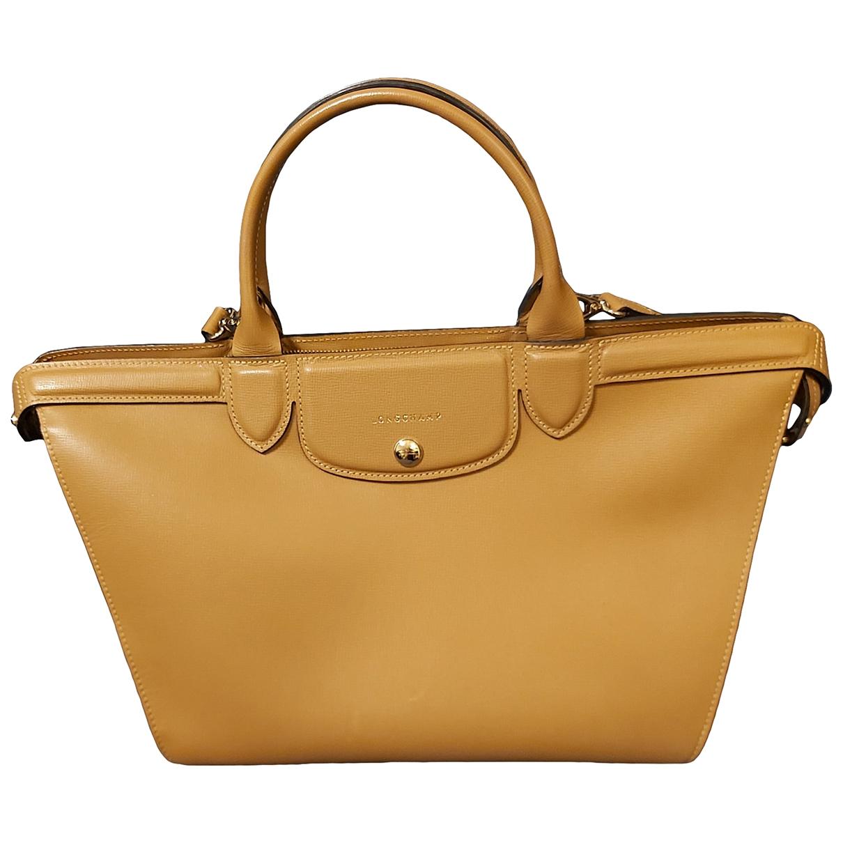 Longchamp Pliage  Beige Leather handbag for Women \N