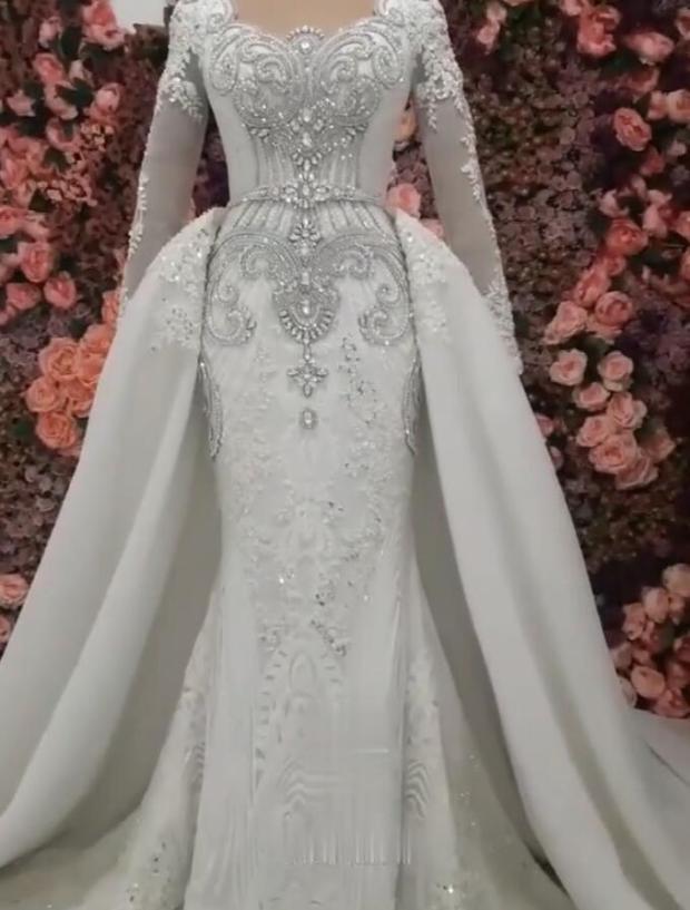 Elegante lange Ärmel Meerjungfrau Brautkleider mit Uberrock