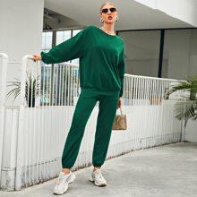 Conjunto pullover de hombros caidos unicolor con pantalones deportivos