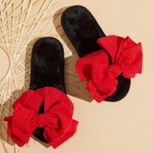 Zapatos fuzzy de punta abierta con diseño de lazo