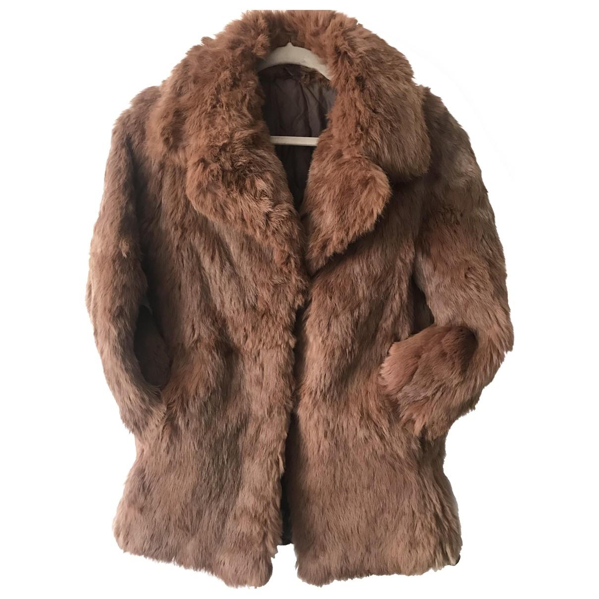 - Manteau   pour femme en lapin