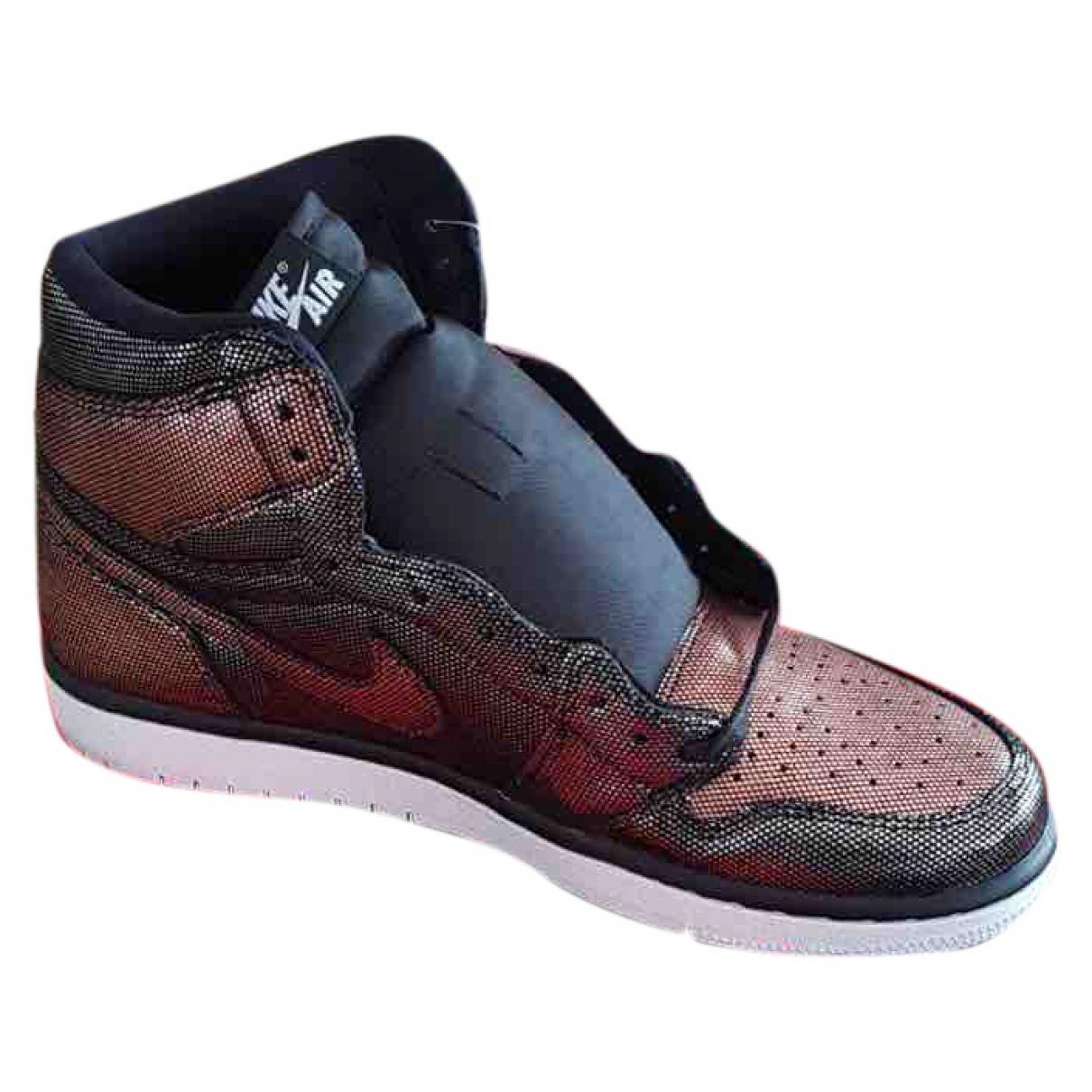 Jordan - Baskets Air Jordan 1  pour femme en cuir verni - noir