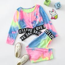 Camiseta con tira cruzada con estampado de letra con pantalones